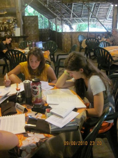 UW undergrads catch up on the literature about coral reef conservation while on Kosrae, Micronesia